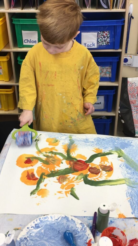 Young boy working with paints